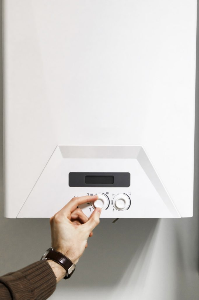 man regulate heating boiler control panel